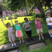 Several Kids holding American Flags