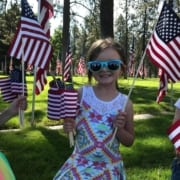 Little girl hold American Flags