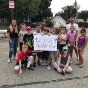 Group of Kids holding Thank you sign